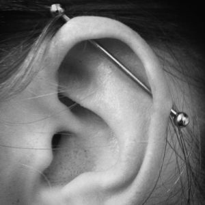 13 step guide to a safe Toronto piercing-industrial piercing shown